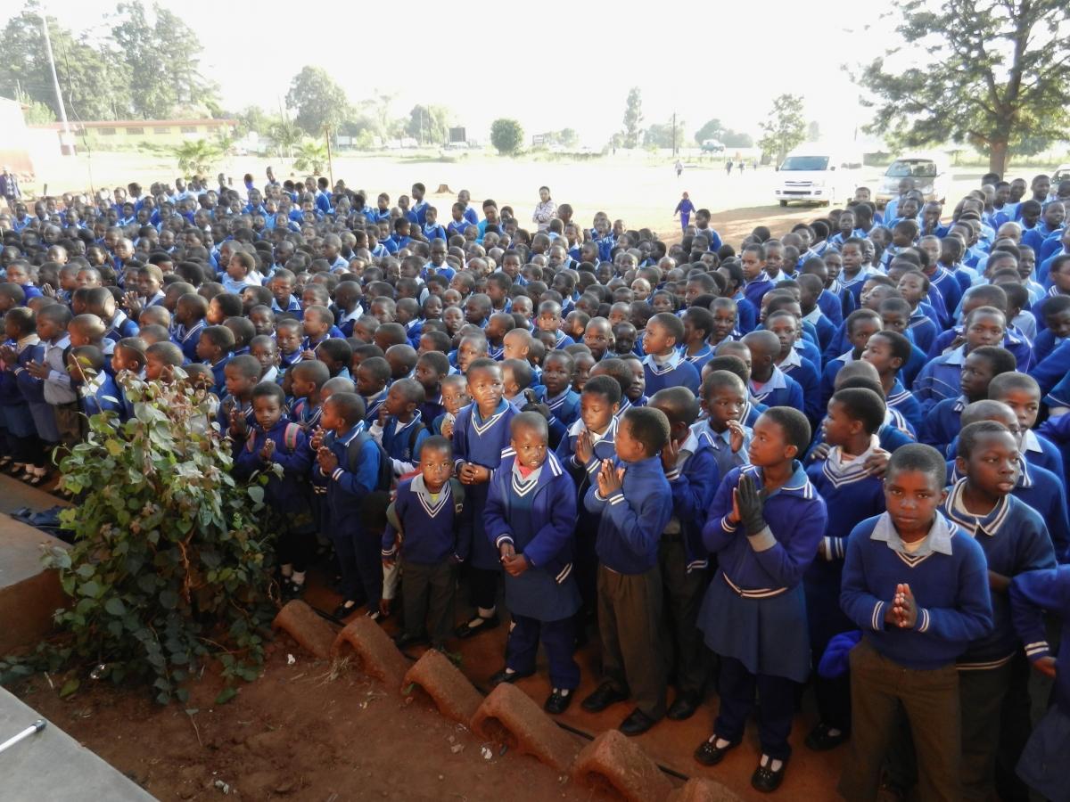 Primary school children listen to Doster & Engle